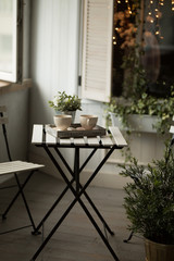 Two cups of tea or coffee on table at morning in loft interior