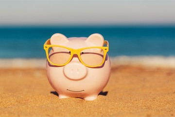 Summer piggy bank with sunglasses