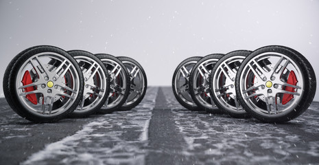 Car wheel, car tire standing on a road. Concept winter tyres. Winter tires with snowy background. Car tire with a disc standing on the road. 3D illustration