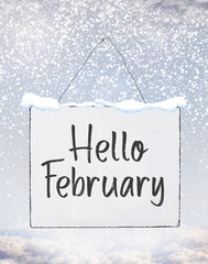 Hello February text quote on white plate board banner with cold snow flakes