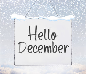 Hello December text on white plate board banner with cold snow flakes
