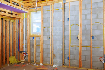 New residential construction home framing with basement view
