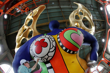 "Conservators Marty and Mueller are seen during restoration works on the sculpture ""L'ange protecteur"" by Saint Phalle  at the central railway station in Zurich"