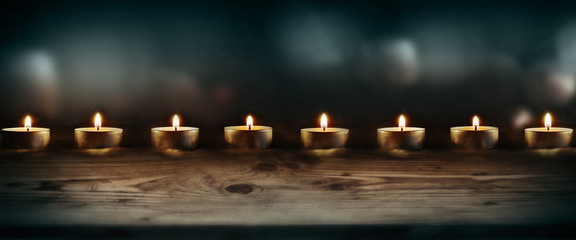 Burning candles with dark blue background