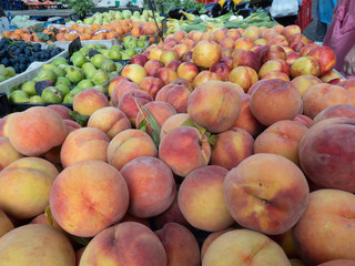 Fresh fruit at farmers' market: peaches and figs