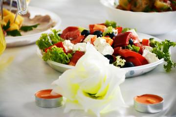 Sliced vegetables on a plate. Salad. Mixed vegetables