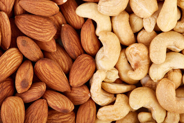 Cashew and almonds on a white background. Healthy food. Nuts.