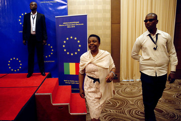The head of the EU observer mission, Cecile Kyenge, leaves after delivering a news conference in Bamako