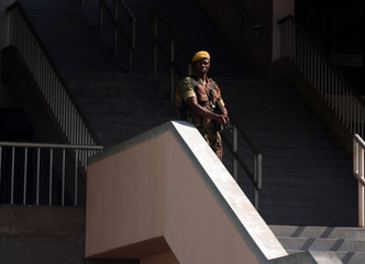 A member of the Zimbabwe Defence Forces stands guard during the Defence Forces Day Commemorations at the National Sports stadium in Harare