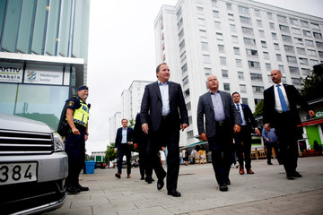 Swedish Prime Minister Stefan Lofven and Justice Minister Morgan Johansson visit local police at Frolunda Square in Gothenburg