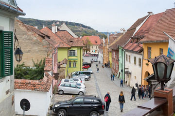 School Street in the castle of old city. View from the balcony of the cafe La Scara (On The Ladder). Sighisoara city in Romania