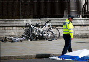 Bicycles lie on the ground at the scene after a car crashed outside the Houses of Parliament in Westminster, London
