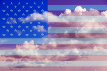 American flag against the sky and clouds