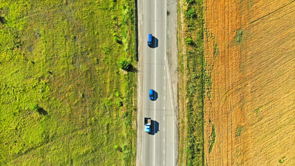 Aerial view of a traffic on a highway between two fields