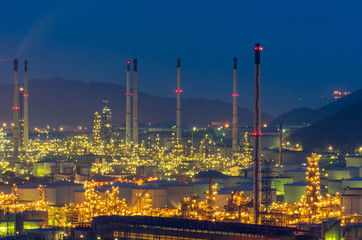 light-up on oil refinery factory night view with mountain