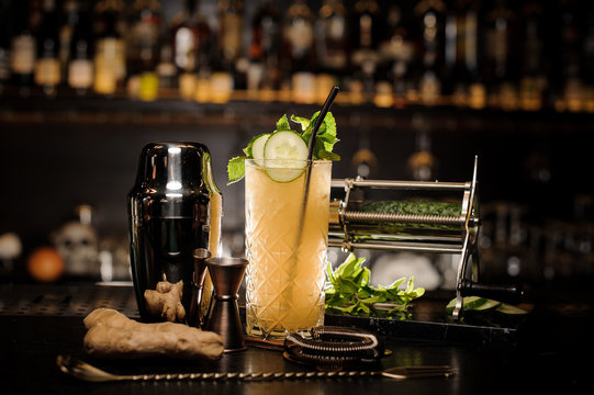 Fresh, cool and sour summer cocktail with ginger, cucumber and mint