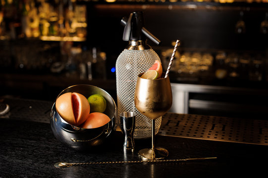 Elegant copper glass filled with sweet summer cocktail with fruit
