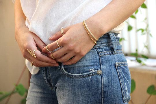 Close up of beautiful woman wearing shiny jewelry