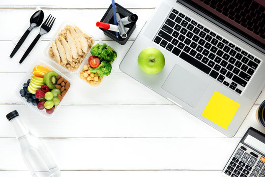 Clean healthy low fat food with laptop computer on working table
