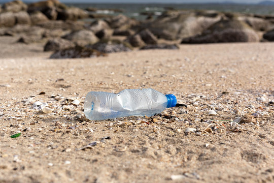 Environment concept trash pollution of plastic bottle on the beach.