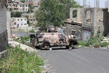Boys sit on damaged APC in Taiz