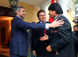 Paraguay's President-elect Abdo Benitez welcomes Bolivia's President Morales to his home ahead of the August 15 swearing-in ceremony in Asuncion