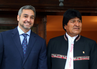 Paraguay's President-elect Abdo Benitez and Bolivia's President Morales pose at his home ahead of the August 15 swearing-in ceremony in Asuncion