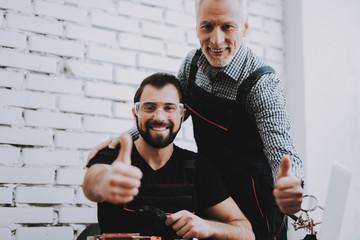 Two Exited Smiling Men in Uniform in Workshop.