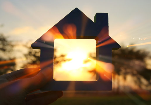Image of vintage house in the grass, garden or park at sunset light.