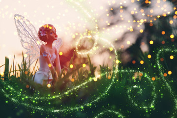 image of magical little fairy in the forest at sunset. Wall mural