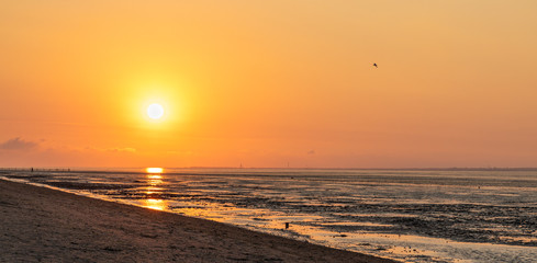north sea sunset with beach