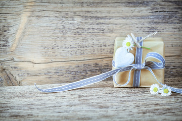 Gift box on rustic wooden background