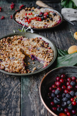 delicious pies with berries on wooden table