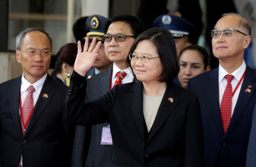 Taiwan's President Tsai Ing-wen waves as she arrives for the August 15 swearing-in ceremony in Luque
