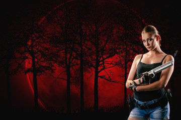 Pistol shooting isolated on red forest background. Sportsman with a gun. Sport pistol shooting.