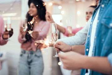Close up al hand keeping alcohol liquid. Positive women keeping indian light during celebration