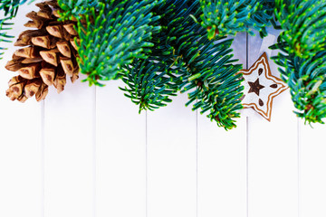Happy Christmas. Christmas pine cone with fir tree branches on white background. Xmas greeting card and border with copy space
