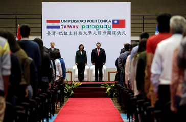 Paraguay's outgoing President Horacio Cartes and Taiwan's President Tsai Ing-wen attend a ceremony in Luque