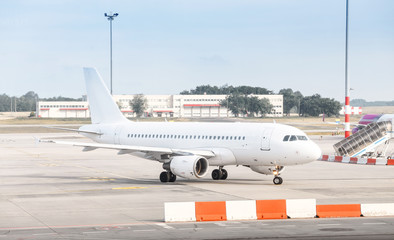 The white plane at the airport taxiway, airline transportation concept
