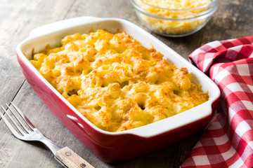 Typical American macaroni and cheese on wooden table
