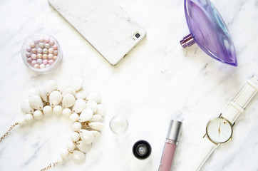 Feminine accessories on a marble desk. Flat lay, top view