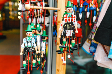 wooden dolls, toys and puppets for sale at souvenir market in Germany