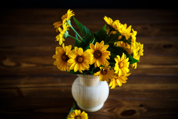 bouquet of yellow big daisies on a black