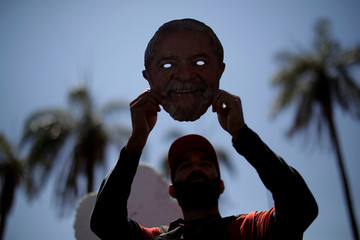 Thousands of Brazil's former President Lula da Silva's supporters walk during the Free Lula March in Brasilia