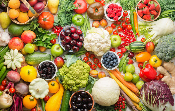 Healthy summer fruits vegetables berries background, cherries peaches strawberries cabbage broccoli cauliflower squash tomatoes carrots spring onions beans beetroot, pepper, top view, selective focus