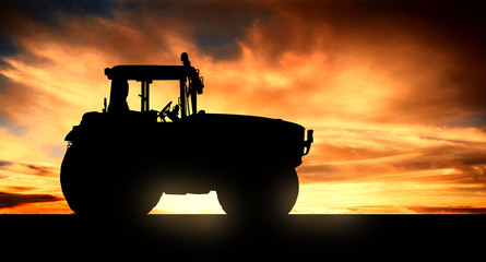 tractor at sunset