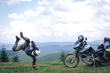 Motorcyclist man and Adventure Motorbike on the top of the mountain. Motorcycle trip. off road Traveling, Lifestyle Travel vacations sport outdoor concept.