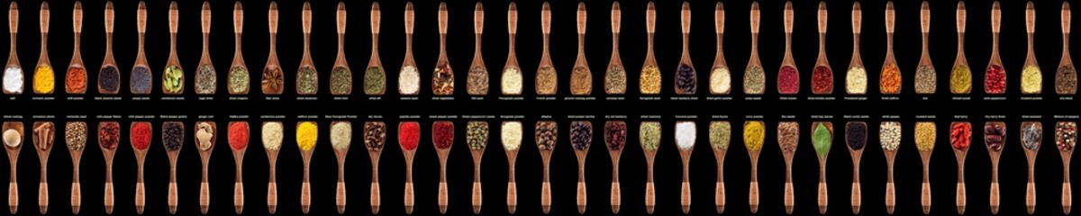 Fototapete - colorful spices and herbs in wooden spoons. seasoning isolated on black background. condiments for food from all over the world