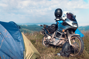 Tent camping on the top of the mountain, motorcycle touring, dual sport enduro, tent and off road adventure motorcycle, active life style concept