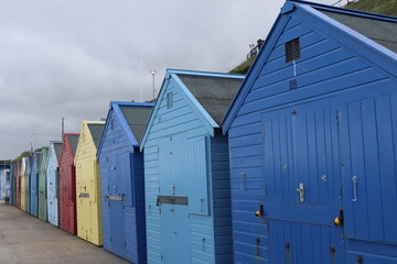 colourful beach huts on mundesley beach front